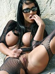 Cony Ferrara posing in black fishnet
