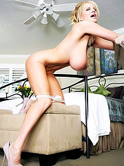 Kelly Madison posing in sexy lingerie
